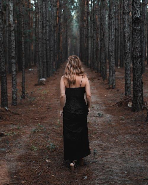 Photo Of Woman Wearing Black Dress