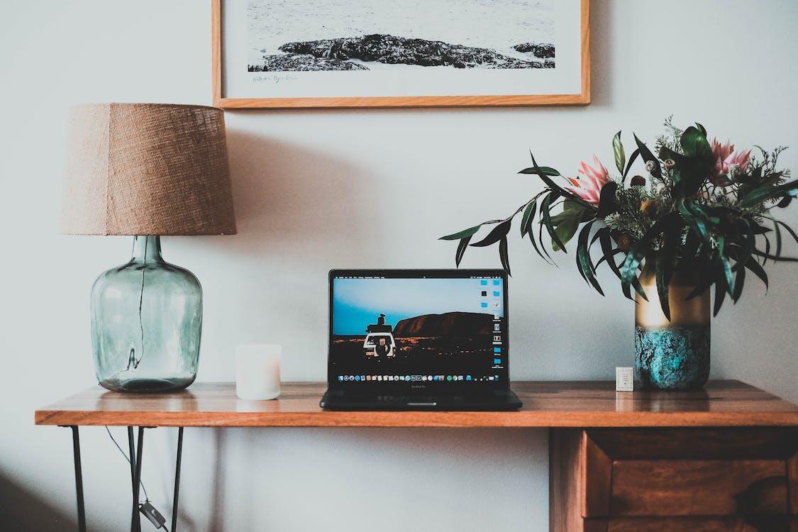 Photo Of Laptop Beside Lamp