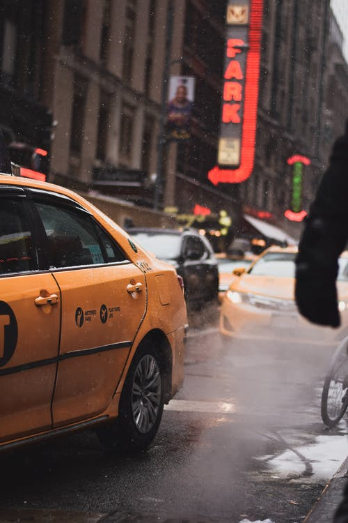 Yellow Taxi Cab on Street