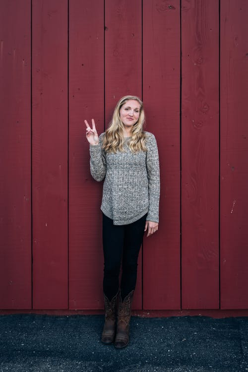 Photo Of Woman Doing Peace Sign