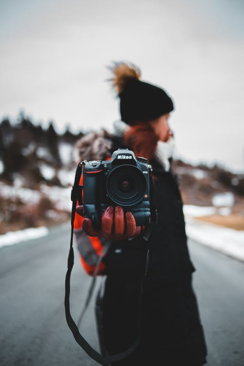 Photo Of Man Holding Black Camera