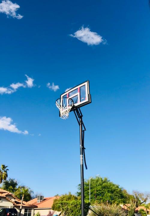 White and Black Basketball Hoop Under Blue Sky