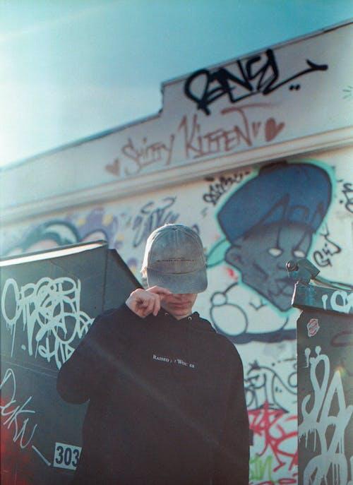 Man in Black Crew Neck Shirt Wearing Gray Hat