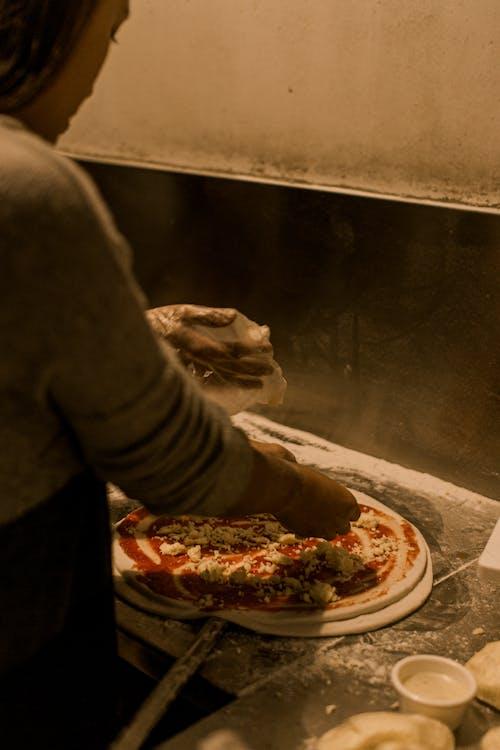 Woman Making Pizza