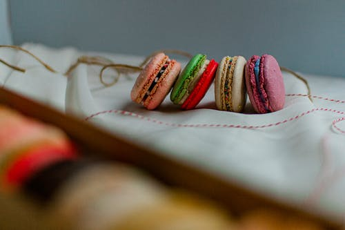 Colorful French Macarons on White Textile