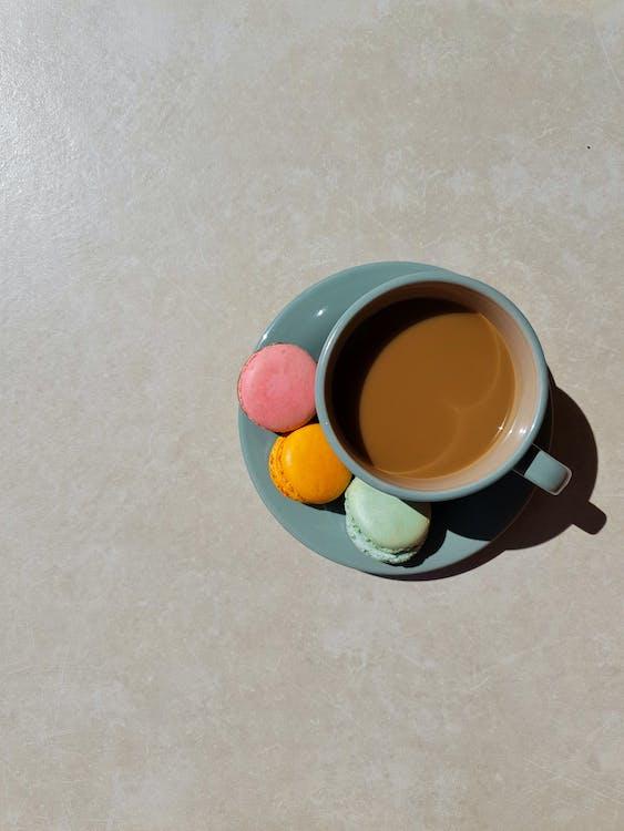 Blue Ceramic Mug With Brown Liquid Inside