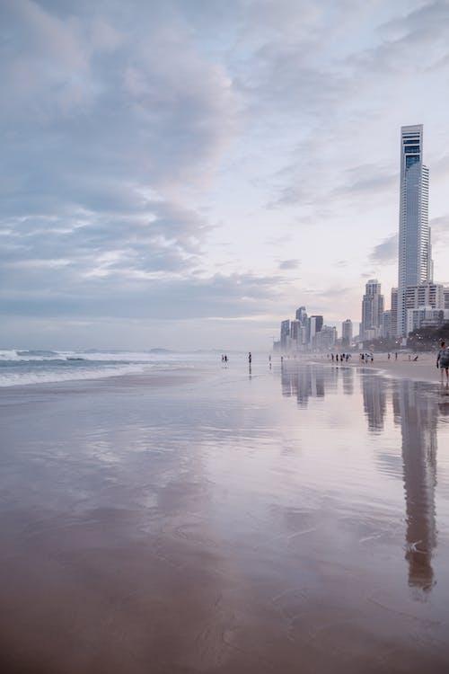 Reflection Of City Skyline Across Body of Water