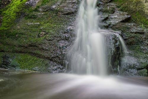 Waterfalls on Green Mossy Rock