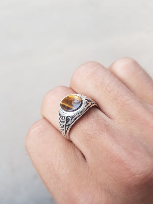 Unrecognizable person with handmade silver ring