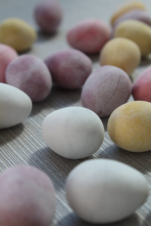 Colorful Easter eggs scattered on table