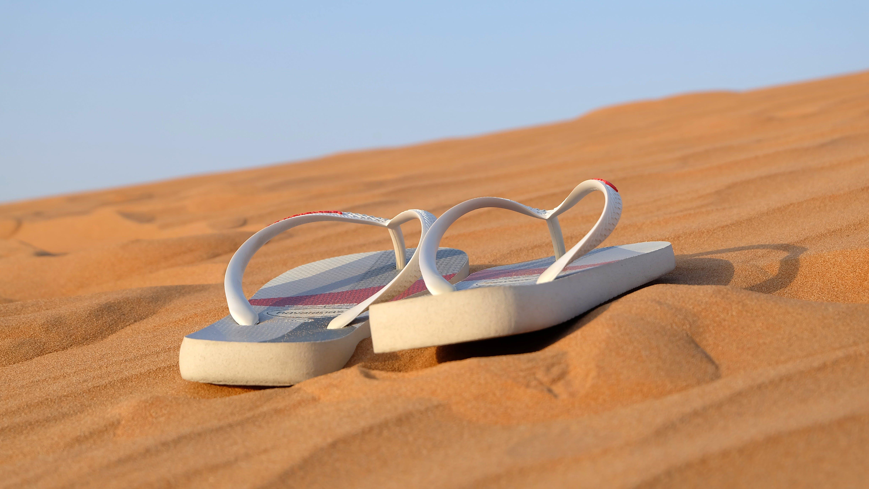Pair of White Flip-flops on Focus Photo