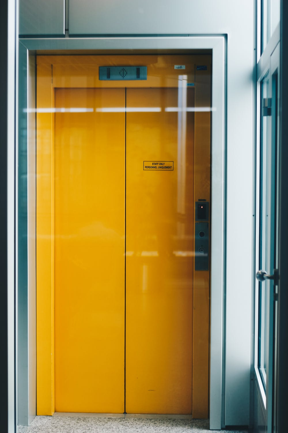 A 'staff only' elevator | Photo: Pexels