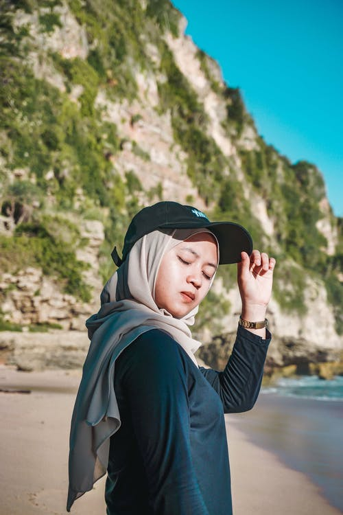 Woman in Black Cap and Brown Hijab