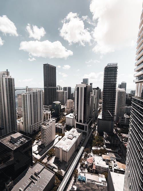 High Rise Buildings Under Blue Sky and White Clouds