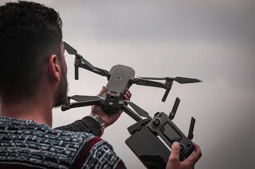 Man Holding Black Drone