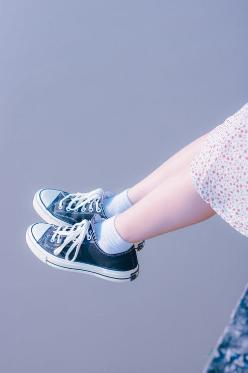 A Person Wearing Sneakers