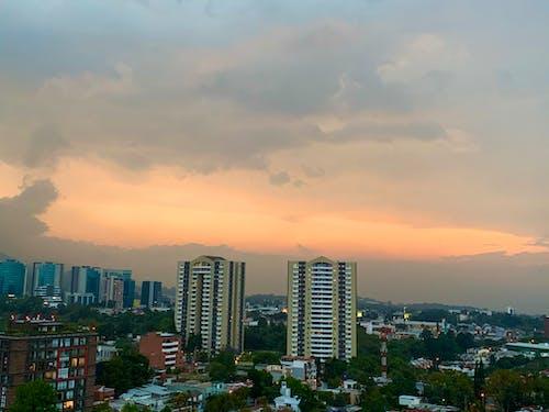 Free stock photo of apartment buildings, beautiful sunset, city sky