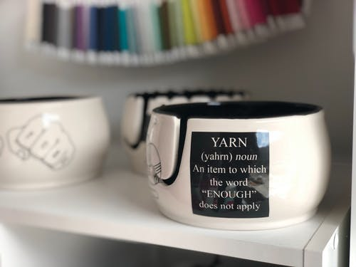 Ceramic cups on white shelf