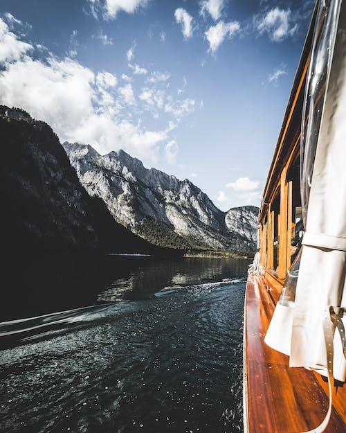 A Ferry Boat Traversing a Lake