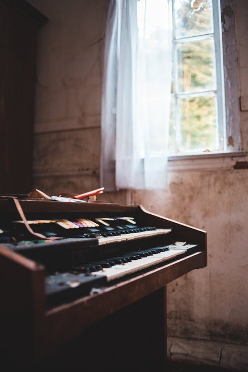 Brown Piano Near Window