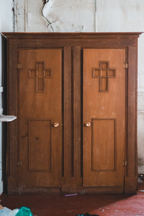 Old shabby double doors in church