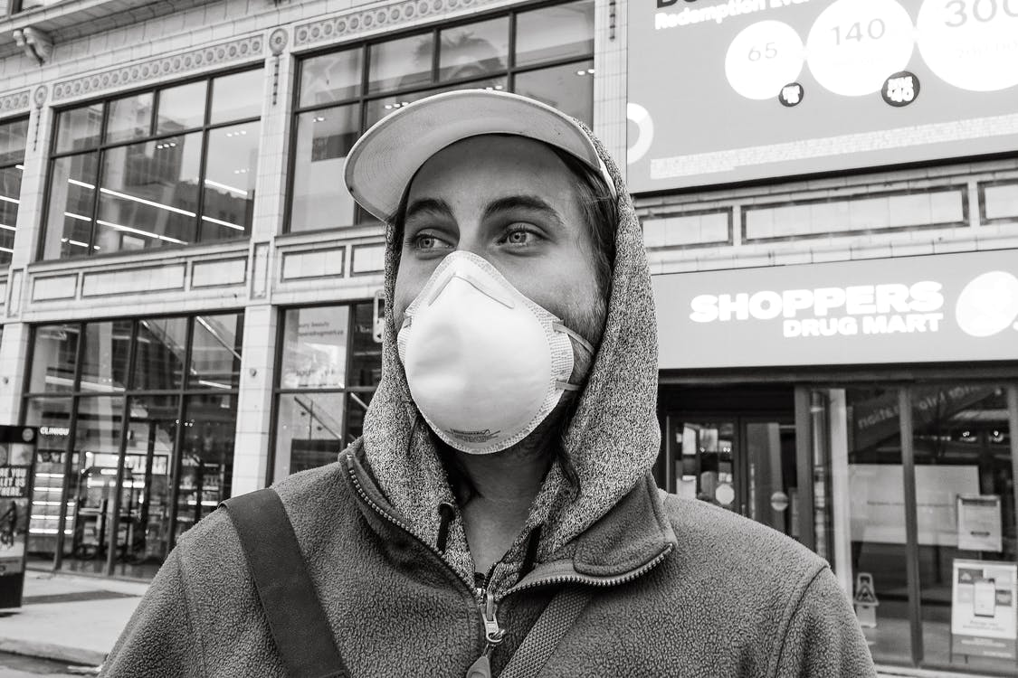 Man in Hoodie Wearing White Mask