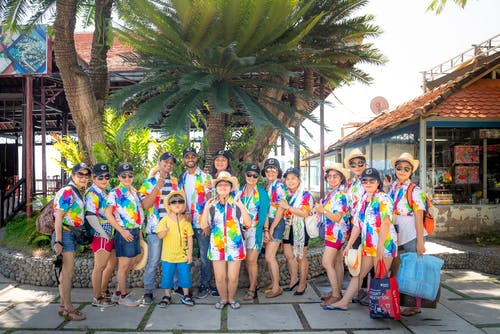 Group of People Wearing Colorful Shirts Having A Picture Taking