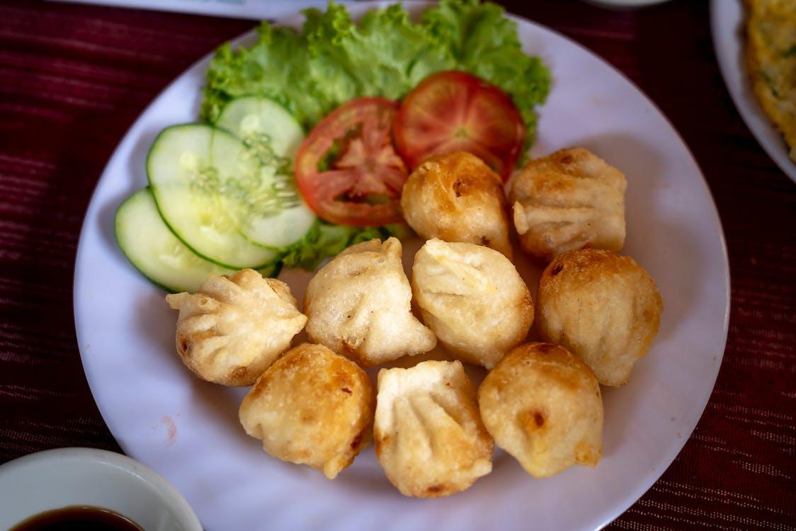 Dumplings Sliced Tomato and Cucumber on White Ceramic Plate