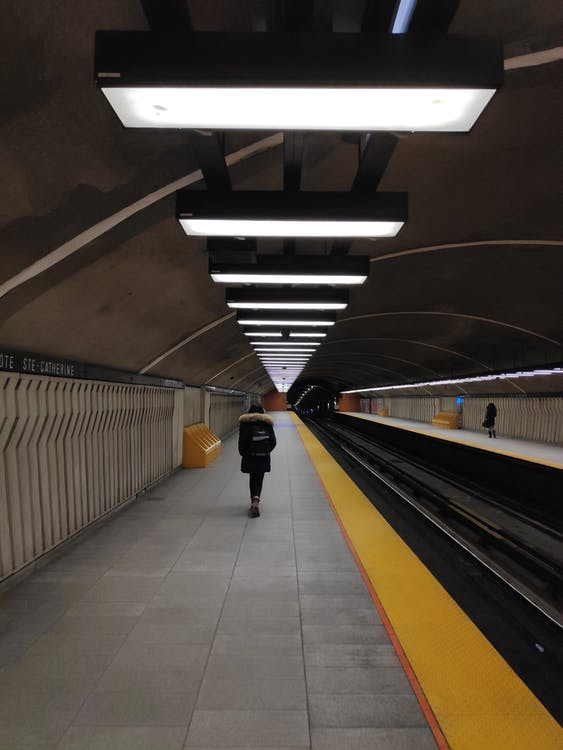 Person Standing on the Platform Waiting for the Train