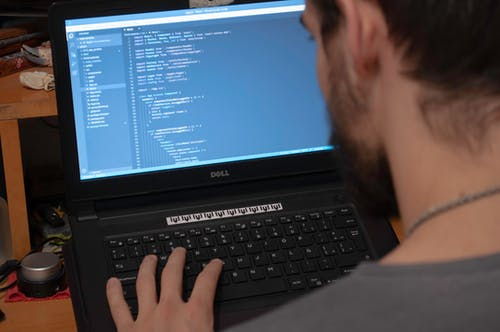 Person Using Black Dell Laptop Computer