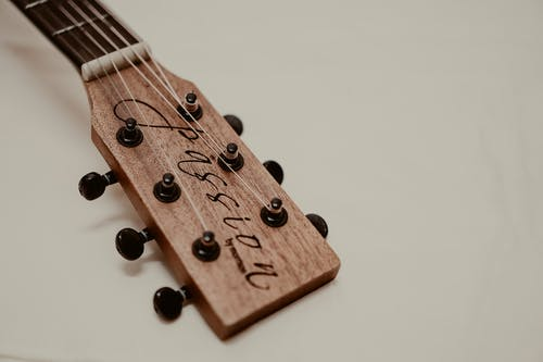 Brown Guitar Headstock on White Surface