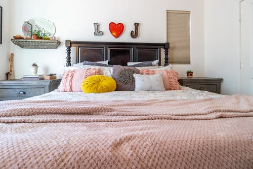 Large bed with pillows in middle of bedroom