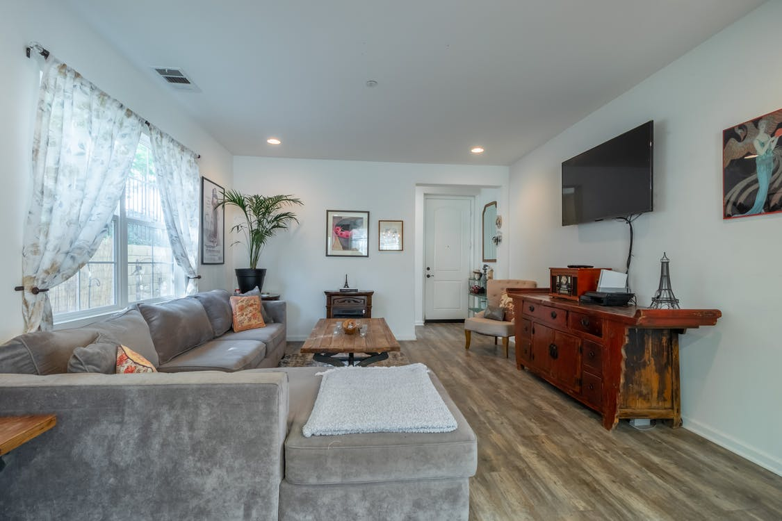 Gray Couch Beside Brown Wooden Table