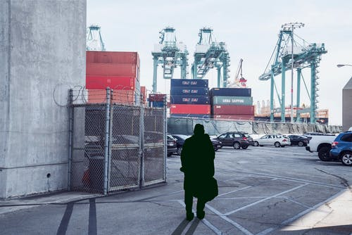 Unrecognizable man standing in cargo port