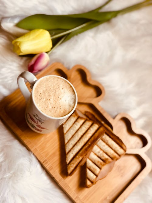 White Ceramic Mug on Brown Wooden Coaster