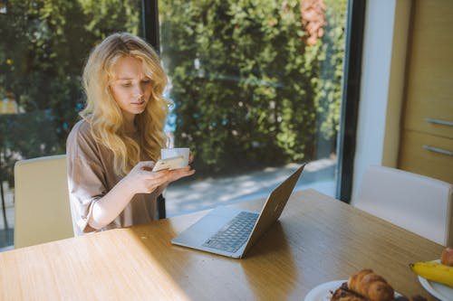 Woman With Coffee Cup Texting