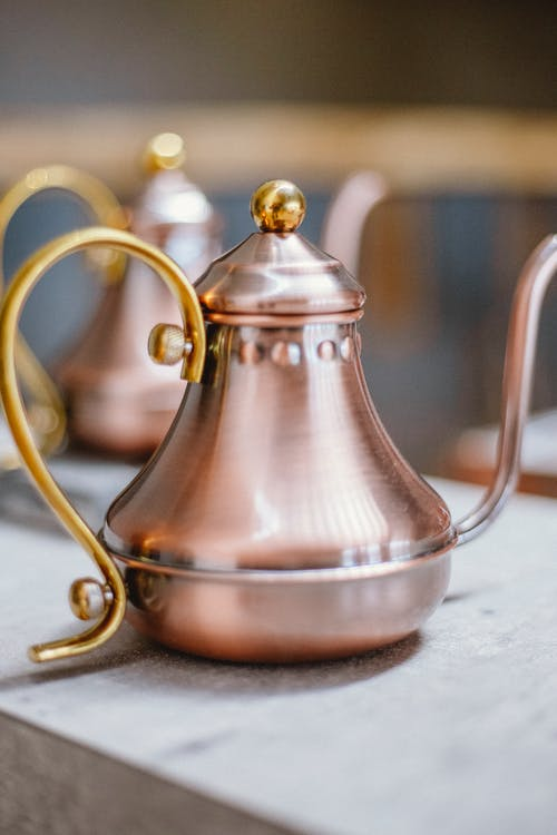 Rose Gold with Gold Handle Teapot on Table