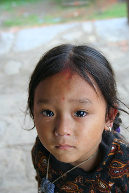 Girl with Tears in Her Eyes