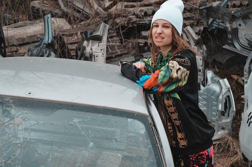 Woman in Black Jacket Standing Beside Car