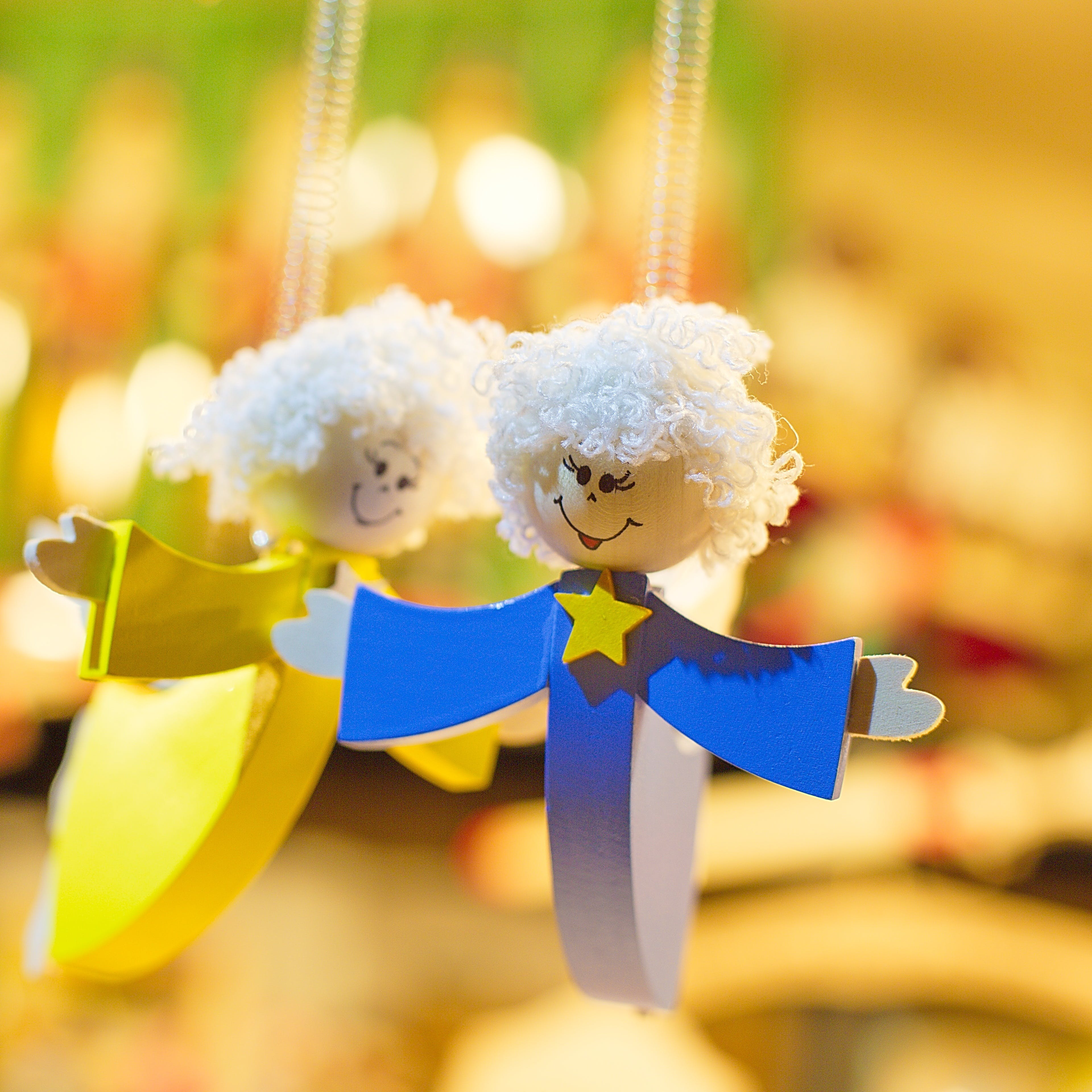 Angel Woman in Blue Dress Pendant Near Angel Woman in Yellow Dress Pendant