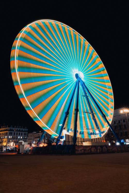 Red and Yellow Ferris Wheel during Night Time