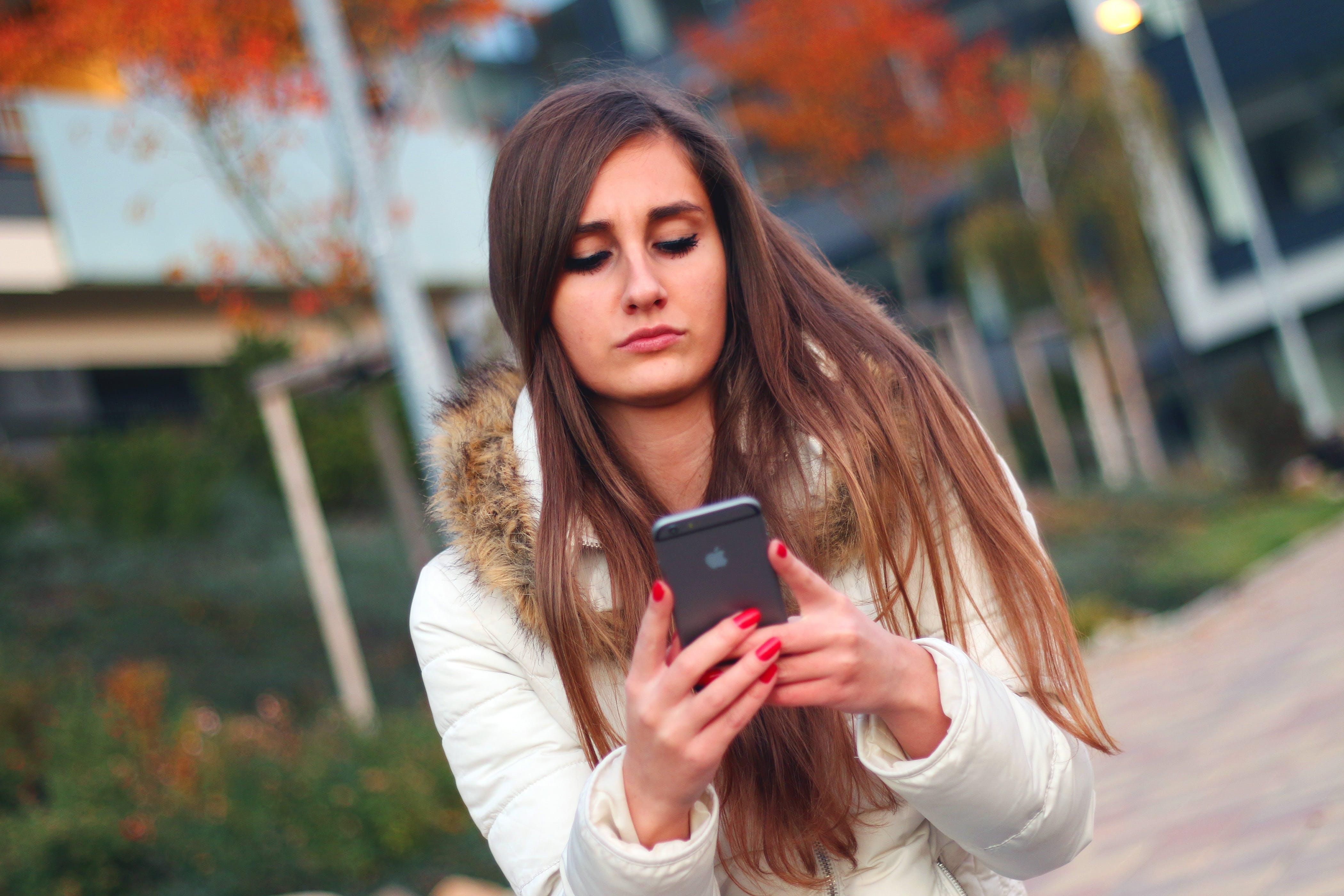 apple inc, brunette, cell phone