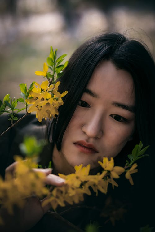 Woman Looking at the Yellow Flowers