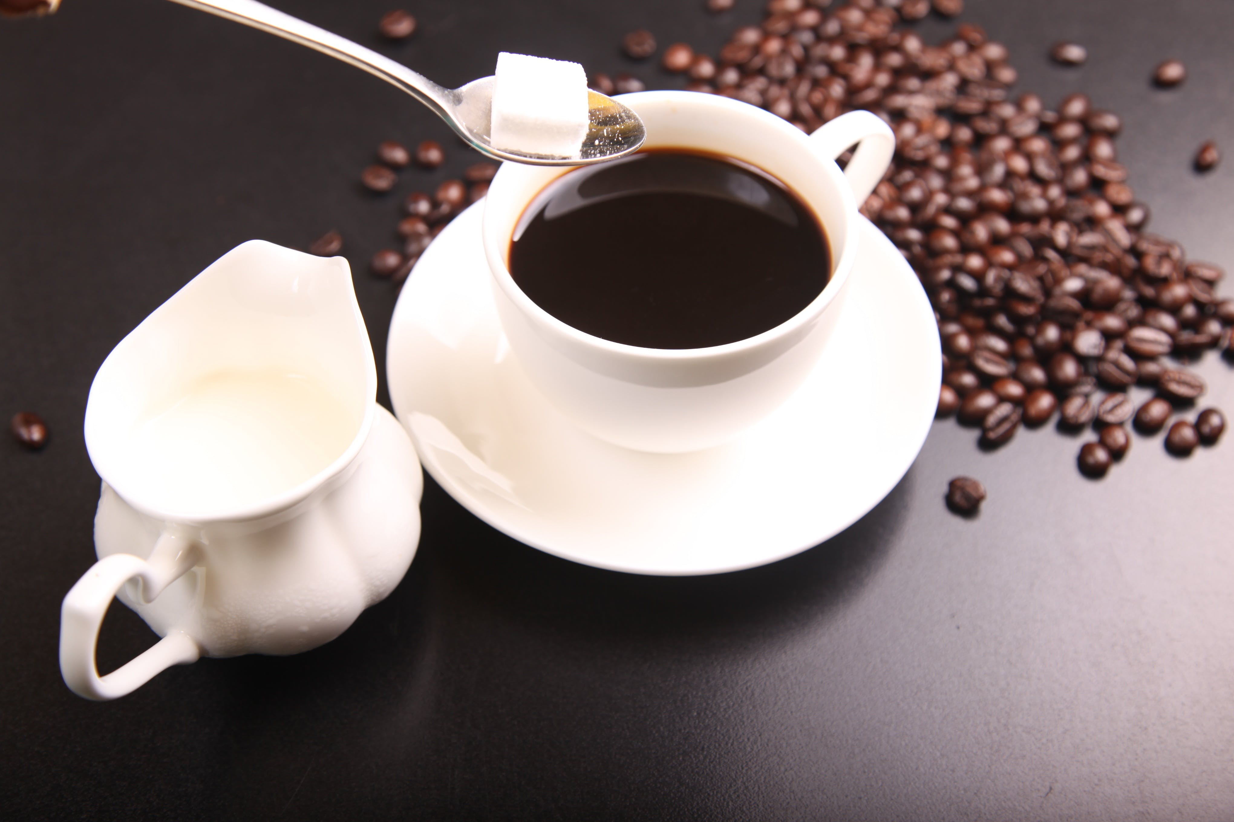 White Ceramic Sauce Boat Beside White Ceramic Cup