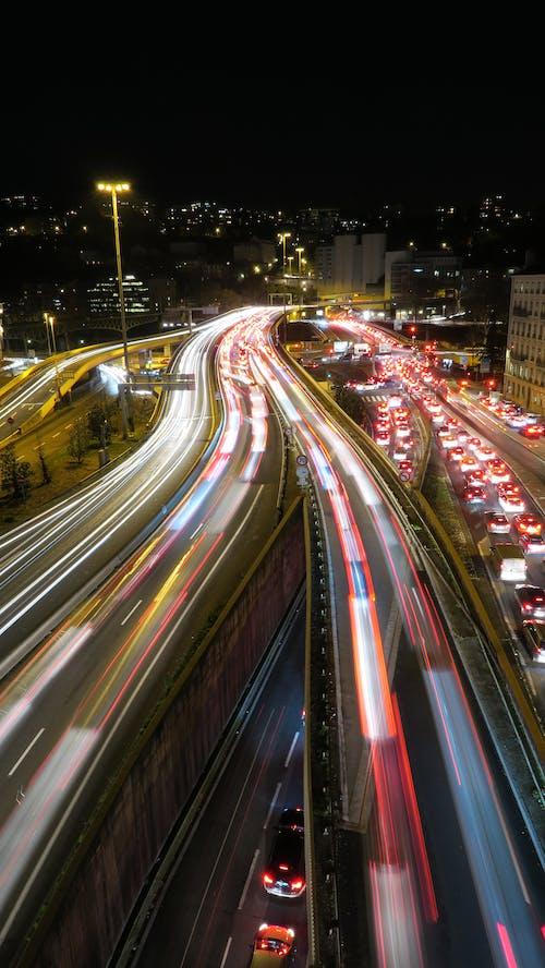 Fotos de stock gratuitas de anochecer, arquitectura, asfalto, autopista