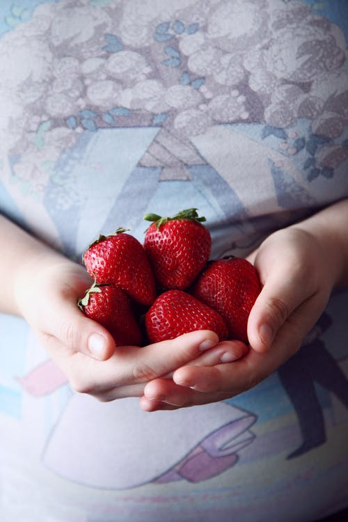 Person Holding Red Strawberries