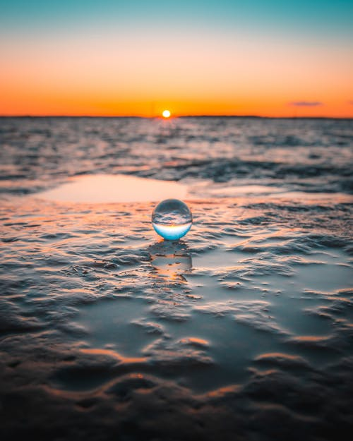 Water Drop on Body of Water during Sunset