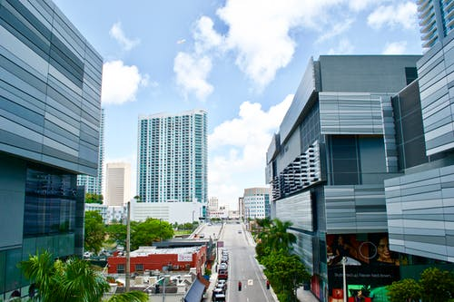 Modern apartment buildings along long road