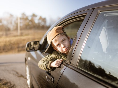 Kid's Head on Car Window