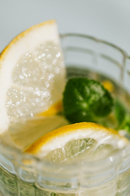 Sliced Lemon in Clear Glass Cup